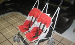 This double stroller is very 'heavy duty'.  It is great for two kids because both seats recline independantly, there is a good-sized basket underneath, there's a five point harness and the seats are nicely padded.  The wheels in the front can lock