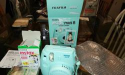 In excellent condition. My daughter only went through 1 roll of film. We still have another packet of film to go with it. Posted with Used.ca app