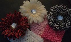 Goegeous flowered headbands for sale. For $5.00 you pick the colour of the headband and the colour of the flower. All flowers are attached with clips and can be interchanged with different coloured headbands to create a stunning look and to complete any