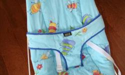 *gentle bouncing motion as baby moves *quilted, clean and removable cover *removable activity bar *from non-smoking home *in excellent condition My baby LOVED this chair!