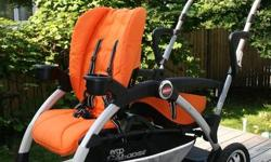"Opened, assemble but never used Joovy Ergo Caboose sit and stand stroller. Includes canopy, cup holders, tray, manual, all documentation, and universal car seat adaptor. Optional ""orange tree"" front and rear seat covers also included. A really cool sit"