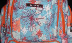 For sale is a Ju-Ju-Be Be Right Back diaper bag in the pattern Groovy Garden. This bag was only used 2-3 times tops. I just didn't like a back pack diaper bag. My loss is your gain! Beautiful vibrant orange interior so you can always find what you are