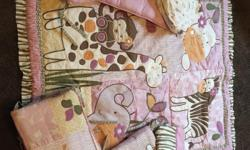 Pink jungle themed crib bedding. Complete with comforter, fitted sheet, bed sheet, and bumper pads.