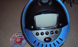 """American Idol Karaoke Machine. Comes with the manual, 2 microphones and one disc. This machine comes with a built in colour video camera and has a 5"""" black and white monitor. You can read the lyrics and watch yourself dance/sing. Hardly used, excellent"""
