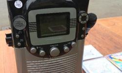 Karaoke machine in excellent condition with three karaoke CDs.