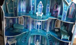 """Our girls are ready to sell their Disney Frozen Mansion! Like new condition and barely used. The lamp, vanity and chandelier light up. Comes with all the original accessories, (all pictured except Olaf on a """"Frozen"""" stand but he is included as well)!"""
