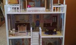 """Accommodates Barbie dolls and other fashion dolls up to 12"""" / 30 cm tall c/w colorful furniture Molded plastic staircase connects the second floor to the top floor Four levels and six rooms of open space Wide windows allow dolls to be viewed from multiple"""