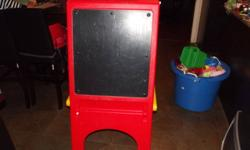 KIDS ART EASEL FOR $5. IT IS MISSING THE TRAYS TO HOLD THE COLORING STUFF BUT OTHERWISE IT'S GREAT FOR THE KIDS TO DRAW ON. CAN DELIVER FOR THE COST OF GAS IF NEEDED. 672-2740