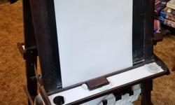 Kids solid wood easel that has storage bins in it and a chalk,whiteboard and paper sides. Great art station. Posted with Used.ca app