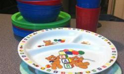 24 pieces that include plates, cups and bowls.  My kids got new ones for Christmas.