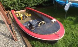 An old boat made into a kids sandbox. Comes complete with a radio, compass and steering wheel. Can come with or without the sand. Lots of imaginary play!!