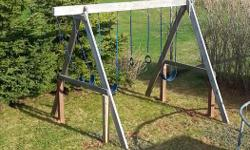 Well built Wooden swing set. 3 Swings set of rings and a yellow 10 ft plastic slide (slide not shown in picture). Swing set in very good shape.