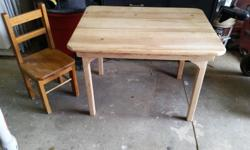 Kids craft table and one small chair..soild wood. Could use a coat of paint, but otherwise in good condition. Chemainus.