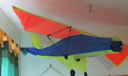 colourful, clean kite, used as a ceiling decoration in boy's bedroom, no longer needed, non-smoking home, can still be used as a kite, tails not showing are included asking $20.00