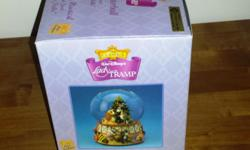 """Lady and the Tramp snowglobe. Mint Condition in box. Plays """"Deck the Halls""""."""