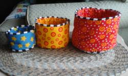 3 nesting cups Small one has crinkle sound and mirror inside, Yellow one has crinkle sound and a see through bottom Large one has no sound and a happy face bottom