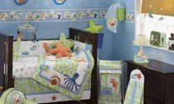 """Baby of Mine Carries Lambs & Ivy We currently have the """"Bubbles"""" 6 piece crib bedding and coordinating accessories on SALE!! The 6 piece crib bedding includes -Comforter -Dust Ruffle -Fitted Sheet -Bumper -Valance -Diaper Stacker On SALE for $182.69,"""