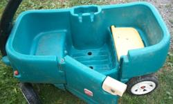 large childs wagon with seats. door to the wagon opens and closes.  1 seat lifts to reveal storage room.    call 604 858 6955