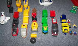large collection of Geotrax, includes: Grand Central Station Crane Windmill Factory Gas Station Suspension Bridge Bell Tower Mountain Tunnel Elevated Bridge Airport Comes with 3 remote controlled motorized trains, one motorized airplane for the airport