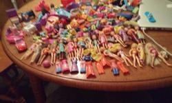 Large lot of dolls including some polly pocket Also a retro small polly pocket car Clothes Accessories Bathroom with sink bathtub toilet and vanity Over 20 dolls Text for a fast reply