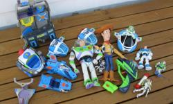 """Large selection of Toy Story toys includes.... Buzz """"build a bear"""" teddy costume Woody doll like in movie Various sized Buzz Lightyears and his vehicles + command center Toy gun that shoot foam discs asking $15 obo Located in weymouth call 837-4128 ask"""