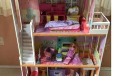 Barbie doll house with elevator and door bell. Stands over 4 feet high and comes with 2 Barbies, all the furniture in pictures and some other accessories. This is a solid house (not made of plastic)and in very good condition. Comes from a pet and smoke
