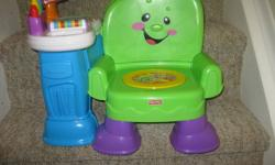 """**In Excellent condition - from a smoke-free home**   Sit right down for storytime, or stand up and play with delightful activities! Up, down and all around, baby will love all the learning fun packed into this musical chair. The """"magic"""" seat cushion"""