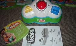 "Grow with me learning system ~ Little Leaps  comes with 1 game ""First Steps"" Baby mode and Toddler mode 2-in-1 Wireless Activity Controller Interactive Learning Disc with 3 Learning Games Storage Case and Parent Guide with additional learning tips TV and"