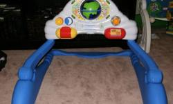Play gym top adjusts so baby can play with it before s/he is able to sit up.  It has a volume setting.  It is an 'Around the World' themed toy.