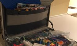 Metal case with misc Leggos, kits, characters, boards and magazines.