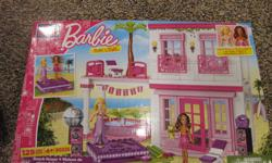 Includes 2 sets of lego - Barbie beach house & Lego Movie lego All pieces included.