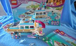 Retired Lego Friends Dolphin Cruiser all pieces together fully assembled with box and instructions.