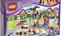 With the Heartlake City Pool by LEGO Friends, every day can be summer vacation. This colorful set has everything the Andrea and Isabella mini-dolls need to have some fun in the sun. Your child can make them zip down the water slide into the pool, cozy up