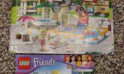 Includes 2 sets of lego friends - pool party & kitchen. All pieces included.