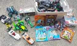 LEGO Pieces and Set Lot. LEGO # 5921 Research Glider (sealed) LEGO # 3848 Pirate Plank (complete) LEGO Mixels # 41517 Balk, 41513 Gobba, 41516 Tentro. 41509 Slumbo (all sealed) LEGO # 41047 Seal's Little Rock (complete) LEGO builds from various sets