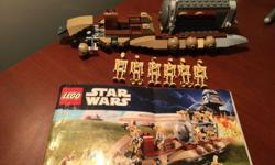 This is a genuine LEGO Star Wars set #7929, called Battle of Naboo. This 2011 LEGO set has been prebuilt and has about 220 pieces. Includes 6 mini figure droids and the original instruction manual. Measures 28 x 26 x 5 cm. Some minor pieces missing. In