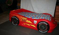 LIghtning McQueen toddler bed with mattress. This is a like new item - my son slept in it maybe 5 times - HATES to sleep alone even to this day. Bed is in perfect shape - no peeling stickers. Pick Up only