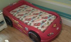 Toddler's racecar bed in the shape of Lightning McQueen from Cars. Purchased new a few years ago, still in great condition. A few scratches on two of the stickers but otherwise fine and structurally solid. Plywood base, assembly instructions, and Cars