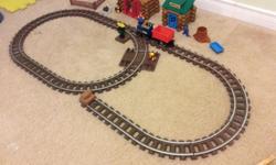 This set comes with what you see in the picture and much more. There are more train tracks and Lincoln logs to build more cabins and forts. There are also few more little people to play with.