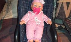 Hello....I'm Kimberly and I'm selling a little baby girl doll to you. She's quite tiny, lightweight and is in terrific shape. The doll also has a magnetic soother that instantly clamps onto her mouth. She's really cute and would be a great little toy for
