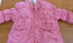 Like New Girl's 2 Piece Snowsuit, worn a couple of times . Size 12 Months....This snowsuit is really a pretty bright pink, but unfortunately, the camera does not show the colour very well....