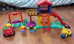 Little People park comes with structure, swing, trike and four dolls.
