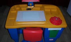 LITTLE TIKES Desk with Swivel Chair in good condition great for crafts, drawing & tracing and other activities 3-WAY LIGHT SWITCH- on (light from above), off, or light from the bottom (which allows for easy tracing) -lots of storage space, 2 drawers and
