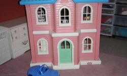 Large plastic dollhouse, Barbie doll size. Stand almost 4 feet high. Comes with pictured furniture and a car. Great condition. Would make a great Christmas gift! Pick up in Ingersoll.