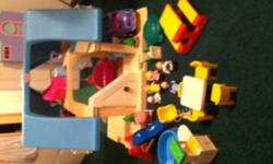 Great Little Tikes Dollhouse. Comes with 4 dolls,1 baby, car sand box, play house, furniture, plus more. Great for all ages. In very good condition. Comes from a smoke free home. Please call 256-4654 or e-mail.