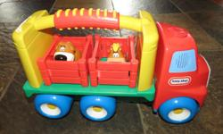 Includes truck with handle, 2 animals with moveable fencing pens and sounds.