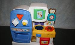 Little Tikes kitchen - lights up and makes noises. Comes with cheese, egg and milk carton shapes that push through the shape cutouts in the fridge door. Pick up only