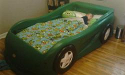 Green race car bed frame holds a twin mattress (not included). Bed frame is in excellent used condition from a smoke-free , pet-free home. Mattress and bedding not included.