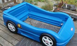 Blue car bed by Little Tikes toddler size. From smoke and pet free home. Great shape the only flaw is the labels on 2 of the wheels are missing. Included is a mattress, the mattress cover should probably be replaced but the mattress is in good condition.