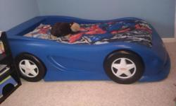 Toddler Car bed in good condition. Can come with cars pillowcase and bedding if wanted for extra. Mattress size is crib. Also have a matching blue dresser.